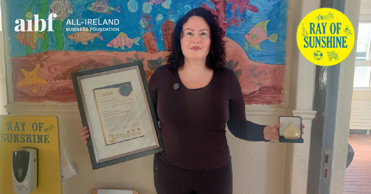 Amanda Spiteri, Founder of Ray of Sunshine After School Services with her All-Star Accreditation certificate and medallion.
