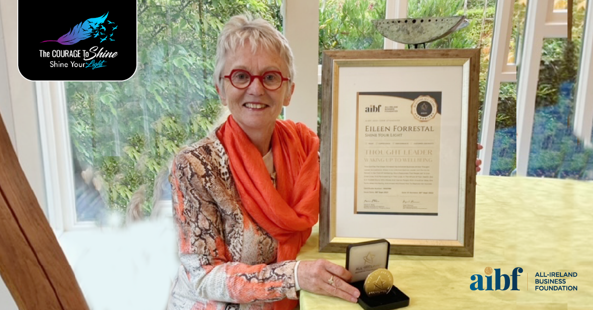 Eileen Forrestal, founder of Shine Your Light with her All-Star Accreditation certificate and medallion.